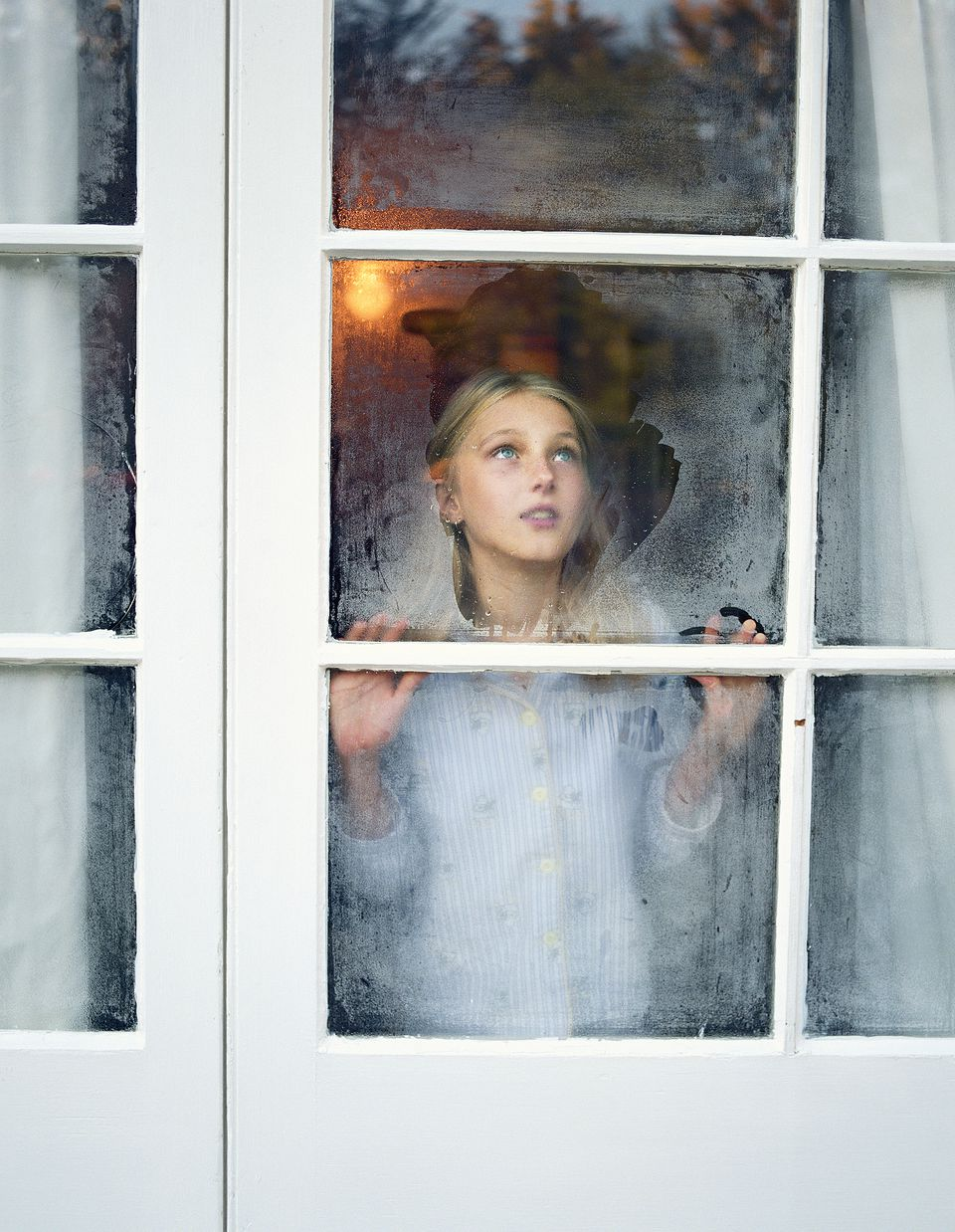 Girl-looking-out-window-GettyImages-200148753-001-586eca985f9b584db3e2c756.jpg